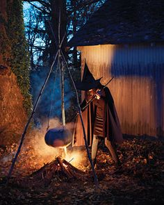 witch stirring caldron held up by wooden branches made into tripod