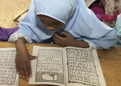 A Kenyan Muslim child reads verses from the Koran, Islam's holy book, on the 11th day of Ramadan at a madrassa (religious school), in Nairobi, Kenya, on June 28, 2015.