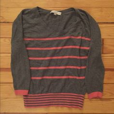 LOFT Pink Striped V-Neck Sweater LOFT pink striped v-neck sweater. Very comfortable, loose fitting throughout top of sweater. Bottom has tighter band which flatters the waist line. ❌ NO TRADES PLEASE! LOFT Sweaters V-Necks