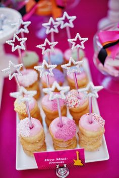 like this idea but it's too girly. we're wanting more gritty than this. love the star wands and donuts but would go with other colors