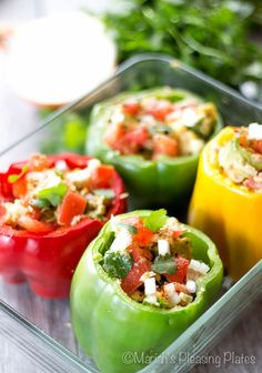 Couscous stuffed bell peppers topped with an avocado and tuna salad. This twist on a classic is quick, easy, and healthy weeknight meal.