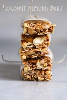 Feasting at Home: Coconut Almond Bars || raw almonds lightly toasted, raw cashew lightly toasted, unsweetened Coconut flakes lightly toasted, honey, water, pinch salt, vanilla (optional). Other ingredients to add: dried fruit, any other nut, seeds (chia, sesame, flax, poppy), vanilla, puffed rice or millet. #sweet #cookie #nut