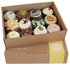 Box of a dozen big cupcakes crumbs and doilles