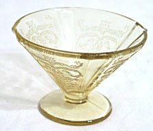 These are Depression Glass cone sherbets in amber in the Madrid pattern made by Federal. They are all in good condition with no chips or cracks.
