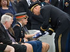 Funeral at arlington cemetery sitting alongside her son army lt