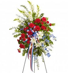 Honor a special Patriot with this memorial featuring red, white and blue flowers.