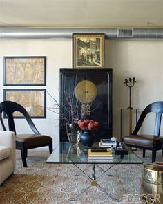 A 1970s Maison Jansen cocktail table and an antique Chinese lacquered cabinet.