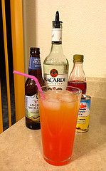 The Angry Cuban 1.5 oz Rum, 1/2 Can (3 oz.) of Pineapple Juice, 1/2 Bottle of Angry Orchard, and a Splash of Grenadine. Perfect to share with a friend!