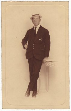 French gentleman in suit and tie wearing a straw hat. Edwardian photo postcard.
