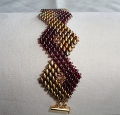 beaded bracelet, bead woven bracelet, Art Deco style bracelet in gold and maroon, beaded cuff bracelet, super duo bracelet