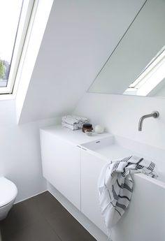 Minimalist bathroom. I would lighten the floor color a bit, but I appreciate the practicality of dark floors.