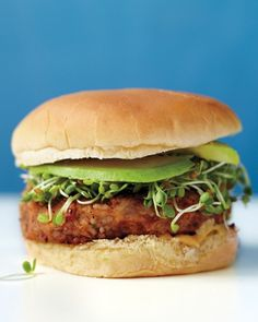 7 of 38  Veggie Burgers Bulgur wheat and pinto beans make a hearty veggie burger. Pan-fry the patties in olive oil and serve on buns with avocado and sliced tomatoes. Get the Veggie Burgers Recipe