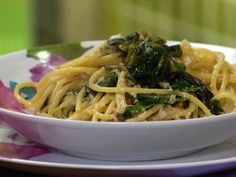 Caesar Spaghetti by rachel ray.  just watched on the show and looks easy!