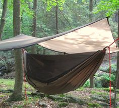 """bushsmarts: """"Ready for the weekend? We'd like to be here right about now, basking in the glory that is fall in New York! (Photo taken in Harriman State Park, NY. And yes, that's our Trail Hammock smartly covered by our Trail Tarp–which also doubles..."""