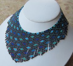 Seed bead necklace. Miyuki beads 15/0 aqua, sky-blue, indigo and amethyst bib necklace.