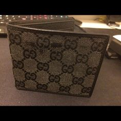 1127b0406a86 Gucci GG Monogram Canvas/Leather Wallet Authentic Gucci men wallet, used  but in good condition; Bifold styling with 6 credit card slots.