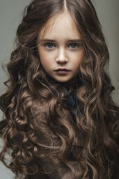 Candra and Weylins daughter (Her hair is black like her fathers but she inherited her mothers curls and blue-green eyes)