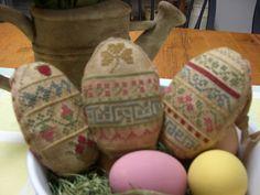 Primitive Cross Stitched Sampler Eggs. $45.00, via Etsy.