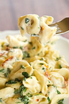Cheese tortellini are tossed in an easy Parmesan cream sauce with spinach and sun-dried tomatoes. An easy dinner ready in less than 30 minutes!