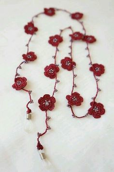 5 petal flower then add another row of crochet to the chain stitches around each bead. Crochet Shoes, Bead Crochet, Crochet Crafts, Crochet Projects, Sewing Crafts, Crochet Lace Edging, Crochet Leaves, Crochet Flowers, Crochet Patterns