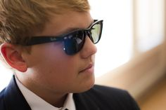Groomsman and nephew of the groom looks cool in his black Ray Bans  http://poppyandjune.com/2015/08/10/real-wedding-jack-pearl/