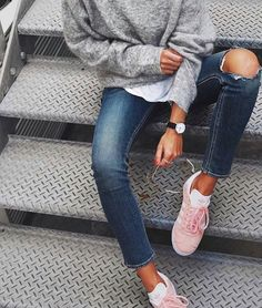 Throwback Adidas sneakers, knee hole distressed jean and minimalist accessories = athleisure