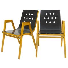 Two Austrian Armrest Stacking Chairs by Roland Rainer, 1950s, Emil & Alfred Pollak | From a unique collection of antique and modern armchairs at https://www.1stdibs.com/furniture/seating/armchairs/