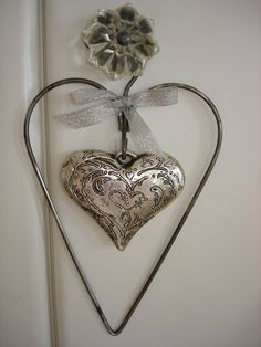 Silver heart within a heart ornament would look so great yr round in my house....on my wish list
