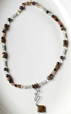 Natural Stone Necklace Featuring Earth Toned Beads and by ScoSiCa, $24.00.    This necklace is great, if I do say so myself, because of all the natural stone beads that are used.  A great variety to be had at only $24.  We used desert jasper beads, rutilated tourmaline beads and red aventurine beads as well, just to name a few!