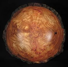 Burls and how to turn them into bowls with beautiful grain figuring and natural bark edges, details with images