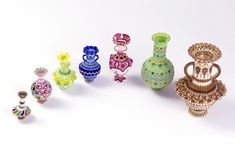 Various bottles / pots made of beads