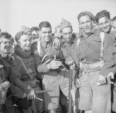 Men of No. 1 Commando in jovial mood at Hastings after returning from a raid on St Cecily Plage near Le Touquet on the French coast to seize...