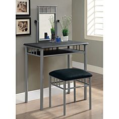 @Overstock - Add a stylish touch to your home decor with this two-piece vanity set. A black finish and vertical swivel mirror completes this table and stool set.   http://www.overstock.com/Home-Garden/Black-Silver-Metal-2-piece-Vanity-Set/6824872/product.html?CID=214117 $137.99