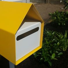 Bright yellow letterbox certainly stands out and creates a talking point. Absolutely love it! EcoBuilt Landscaping Brisbane