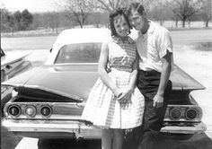 We owned a 1960 Chevy Impala. I remember family pictures and movies of folks posing in front of it, just like this.