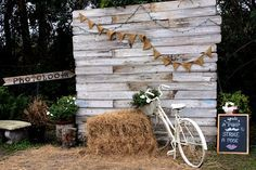 Photo booth - rustic, cute, and country-ish...I think we found a theme...??