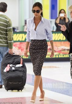 That's a good look! Victoria Beckham stunned in a slinky businesslike ensemble as she arrived at JFK in New York City on Sunday