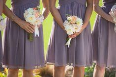 Dusty lavender bridesmaids dresses act as a neutral backdrop to fresh springtime bouquets.  Dahlias, roses, lizianthus.  Lavender Blue Events; Flowers by Kim; Katie DiSimone Photography