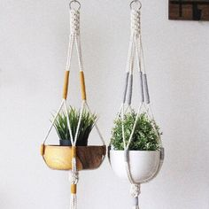 Show your plants some love with this modern, vintage-inspired macrame plant hanger. Simple, yet meticulously hand-crafted, this beauty would be equally at home gracing a living room corner, or brightening up an office. Designed with high quality cotton rope sourced locally within Ontario, this lovely plant hanger is a stylish way to showcase your favourite plants year-round. Suitable for indoor use, and also thoughtful gift for your friends and family who are inspired by nature. Colour: Mustard Macrame Hanging Planter, Macrame Plant Hangers, Macrame Plant Hanger Patterns, Macrame Design, Macrame Projects, Macrame Patterns, Small Plants, Diy Crafts, Colour Gray