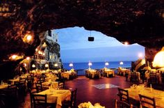 eat in a restaurant in a cave overlooking the ocean http://bit.ly/Hl03Op