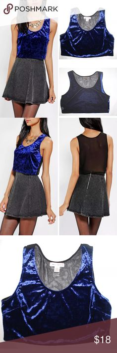 URBAN OUTFITTERS CRUSHED BLUE VELVET CROP TOP NEW URBAN OUTFITTERS BAND OF GYPSIES CRUSHED VELVET CROP TANK TOP   $39 Retail Value  Condition: Brand new without tag, inner label marked  Product Features:  Seriously amazing cropped tank top from Band of Gypsies with a soft, stretchy crushed velvet front and a sheer chiffon back. Cut in a fitted silhouette with a scoopneck.   CONTENT + CARE   Polyester, spandex. Hand wash. Imported.   *this listing is for the blue crop top only other clothing…