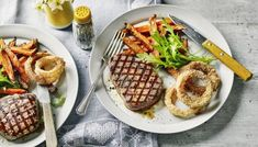 Sometimes only a steak will do, but they tend to be very fatty. Using lean fillet steak helps keep the calories down and serving it with baked onion rings, salad and sweet potato fries mean you're still getting a good amount of vegetables.  Each serving provides 527 kcal, 38g protein, 50g carbohydrate (of which 12.5g sugars), 17.5g fat (of which 5.4g saturates), 8g fibre and 0.6g salt.