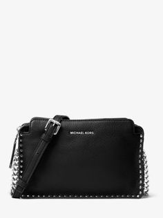 Crafted from soft pebbled leather, our Astor crossbody fastens with a convenient top-zip closure and easily stows your phone, cards, lipstick and more. Complete with a polished chain strap for a hint of shine, our subtle logo gives it signature finish.