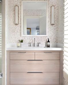 One of our first #RAinteriordesignerwelove: @elizabethlawsondesign and this bathroom featuring our Petals wallpaper in Taupe-blue. See more on The Fold. #rebeccaatwood #RAwallpaper