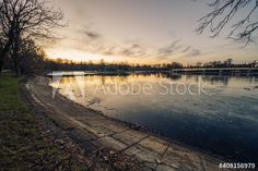 Colorful sky is reflected by the frozen lake in the city park in winter - get 10 free images by registering for 1 month free trial #bucharest #romania #peacefulhunter #city #sunset #sky #lakeview #europe City Sunset, Sunset Sky, Bucharest Romania, Evening Sky, 1 Month, Lake View, Park City, Free Images, Frozen