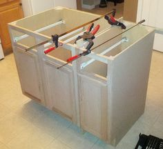 You will first want to line everything up to make sure the cabinets are aligned using wood clamps