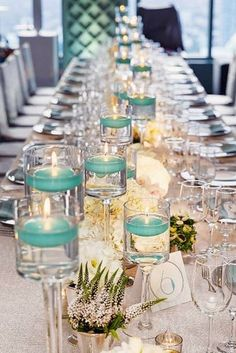 wedding centerpieces with white flowers and blue candles tiffany style colin miller photography