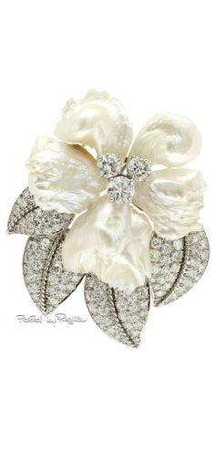 Regilla William Ruser - #brooch. Diamonds, Mississippi Fresh Water Pearl, and Platinum. Circa 1940's.