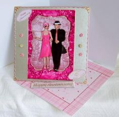 Bright Pink Flapper Couple  on Craftsuprint designed by Vicki Avcin - made by Marion MacKellar - I printed sheet on glossy photo paper, cut out main picture and elements. I used dst to attach main picture to silver embossed card, added the decoupage with silicone glue and put a gem stone on ladies hat and dress, I edged embossed card and picture with border and corner peel offs, added two sentiments and some card candy. I made a twisted easel card, lined the base with contrasting backing…