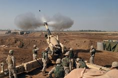 The US Marine Corps (USMC) M-198 155mm Howitzer gun crew of 4th Battalion, 14th Marines, Mike Battery, Gun 4, left to Right, Gunnery Sergeant (GYSGT) Justin Grafton, Cannoneer Private First Class (PFC) Matthew Camp, Section Chief Sergeant (SGT) Mike Dasher, Cannoneer Lance Corporal (LCPL) Josh Rosenberger, Cannoneer Corporal (CPL) Will McGee, Ammunition Team Chief CPL Jonathan Layman and Cannoneer LCPL Jonathan Fox. Marines at Camp Fallujah, Iraq (IRQ), engage enemy targets in support of…